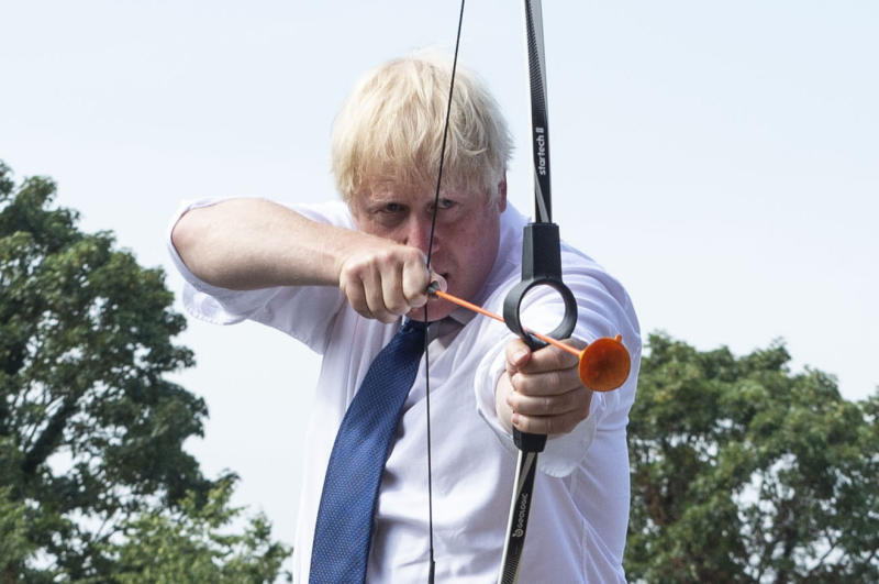 Prime Minister Boris Johnson takes part in archery during a visit to the Premier Education Summer Camp at Sacred Heart of Mary Girl's School, Upminster in Essex.