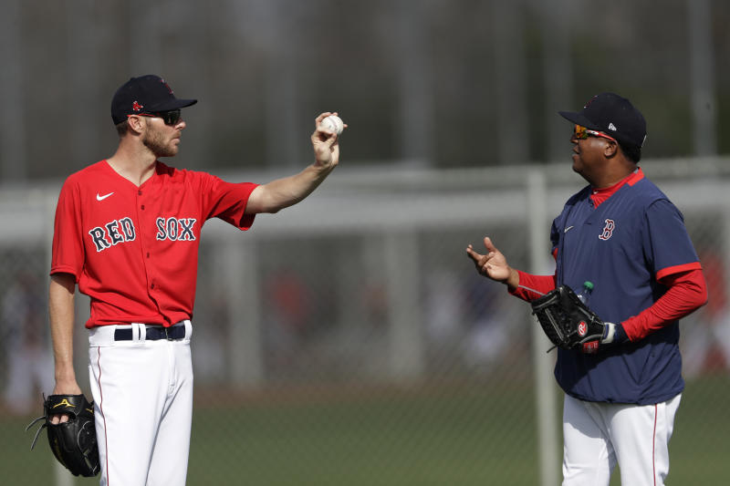 Boston Red Sox starting pitcher Chris Sale, left, talks with Pedro Martinez during spring training baseball camp Wednesday, Feb. 19, 2020, in Sarasota, Fla. (AP Photo/John Bazemore)