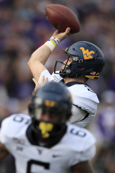 FILE - In this Nov. 16, 2019, file photo, West Virginia quarterback Jarret Doege passes during the first half of an NCAA college football game against Kansas State in Manhattan, Kan. Bowling Green transfer Jarret Doege delivered last week in his first start when West Virginia needed a spark at Kansas State to end a five-game losing streak. Doege is expected to get the call again when the Mountaineers play in their home finale Saturday against No. 22 Oklahoma State. (AP Photo/Orlin Wagner, File)