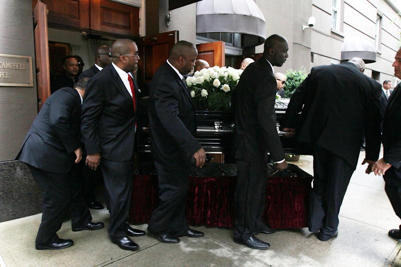 """A casket is carried out of the Frank E. Campbell Funeral Chapel following the service for hip-hop mogul Chris Lighty, Wednesday Sept. 5, 2012 in New York. Mourners in the packed chapel Wednesday included Sean """"Diddy"""" Combs, Missy Elliott, Q-Tip, LL Cool J, Russell Simmons, 50 Cent and Grandmaster Flash. Lighty, 44, was found dead in his Bronx apartment last week with a gunshot wound to the head.  (AP Photo/Tina Fineberg)"""