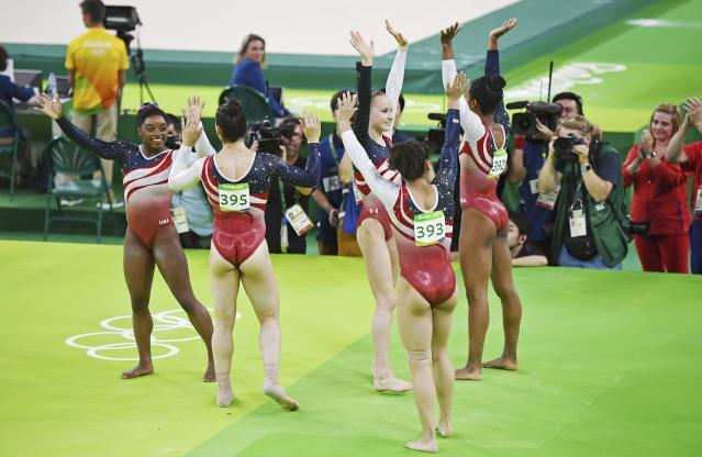 2016 Rio Olympics - Artistic Gymnastics - Final - Women's Team Final - Rio Olympic Arena - Rio de Janeiro, Brazil - 09/08/2016. Simone Biles (USA) of USA, Alexandra Raisman (USA) of USA (Aly Raisman), Madison Kocian (USA) of USA, Laurie Hernandez (USA) of USA, Gabrielle Douglas (USA) of USA (Gabby Douglas) celebrate winning the gold in the women's team final. REUTERS/Dylan Martinez FOR EDITORIAL USE ONLY. NOT FOR SALE FOR MARKETING OR ADVERTISING CAMPAIGNS.