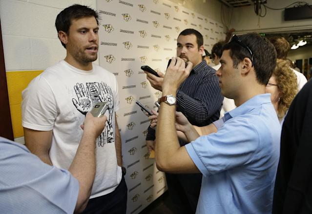 Nashville Predators defenseman Shea Weber, left, answers questions on the first day of NHL hockey training camp Wednesday, Sept. 11, 2013, in Nashville, Tenn. The team will try to bounce back from a rare losing season. (AP Photo/Mark Humphrey)