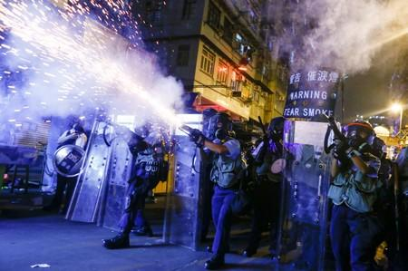 Police fire tear gas at anti-extradition bill protesters during clashes in Sham Shui Po in Hong Kong
