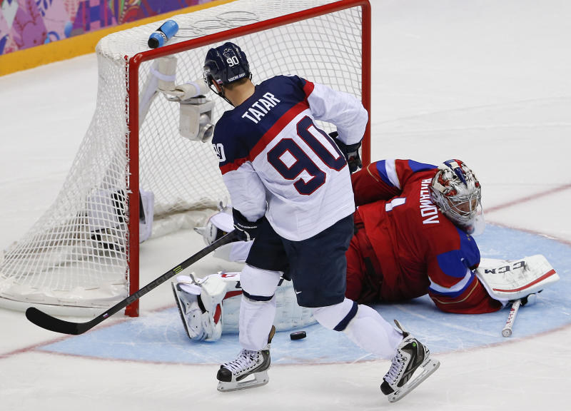Russia goaltender Semyon Varlamov blocks a shot by Slovakia forward Tomas Tatar in a shootout of a men's ice hockey game at the 2014 Winter Olympics, Sunday, Feb. 16, 2014, in Sochi, Russia. Russia won 1-0. (AP Photo/Julio Cortez)