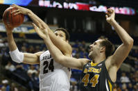 South Carolina forward Michael Carrera (24) shoots as Missouri forward Ryan Rosburg (44) defends during the second half of an NCAA college basketball game in the first round of the Southeastern Conference tournament, Wednesday, March 11, 2015, in Nashville, Tenn. (AP Photo/Steve Helber)