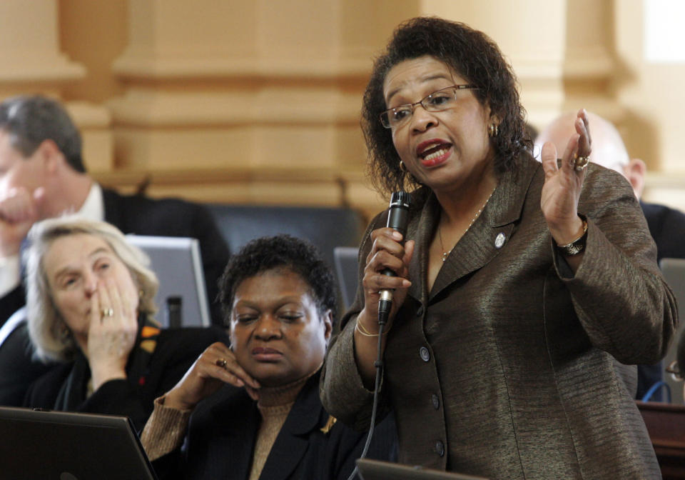 FILE - In this Feb. 25, 2010, file photo, Del. Roslyn Tyler, D-Sussex, right, speaks on the budget as Del. Delores McQuinn, D-Richmond, center, and Del. Betsy Carr, D-Richmond, left, listen during the House session at the Capitol in Richmond, Va. Two of the last remaining rural Democrats in the Virginia House of Delegates, Tyler and Chris Hurst, are being targeted by Republicans hoping to regain the majority they lost to Democrats in both the House and Senate in 2019. Tyler and Hurst reject their opponents' claims and say they've worked hard to improve the lives of the people in their districts. (AP Photo/Steve Helber, File)