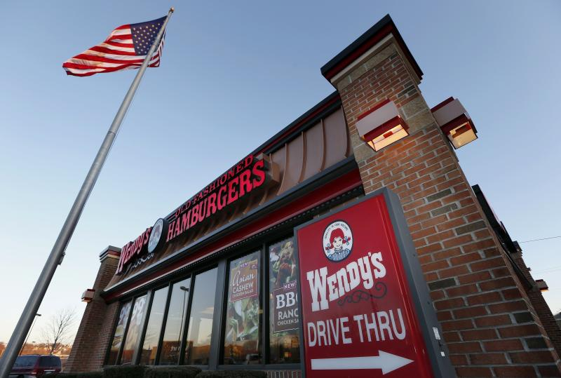 FILE - This Friday, March 21, 2014, file photo shows a Wendy's restaurant in Providence, R.I. The Wendy's Co. reports earnings Wednesday, Aug. 9, 2017. (AP Photo/Michael Dwyer, File)