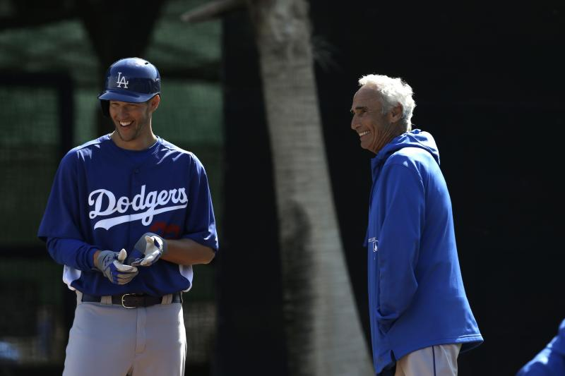 Los Angeles Dodgers starting pitcher Clayton Kershaw, left, laughs with Sandy Koufax during spring training baseball in Phoenix, Thursday, Feb. 21, 2013. (AP Photo/Paul Sancya)