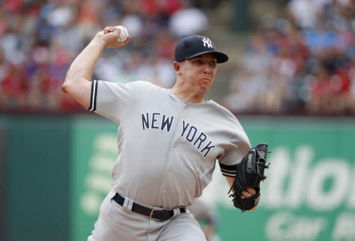 New York Yankees' Chad Green throws to the Texas Rangers in the first inning of a baseball game in Arlington, Texas, Sunday, Sept. 29, 2019. (AP Photo/Tony Gutierrez)