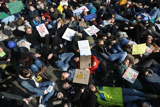 <p>Demonstrators lay on the ground in protest at the March for our Lives demonstration in Berlin, Germany. (Adam Berry/Getty Images) </p>