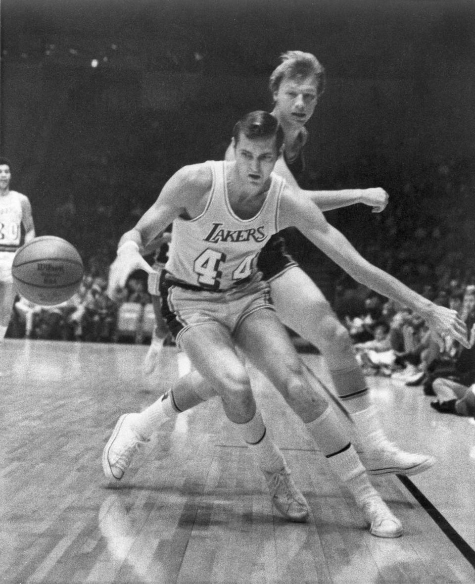 Jerry West steals the ball from Baltimore Bullets' Jack Marin on Nov. 24, 1969, at the Forum.