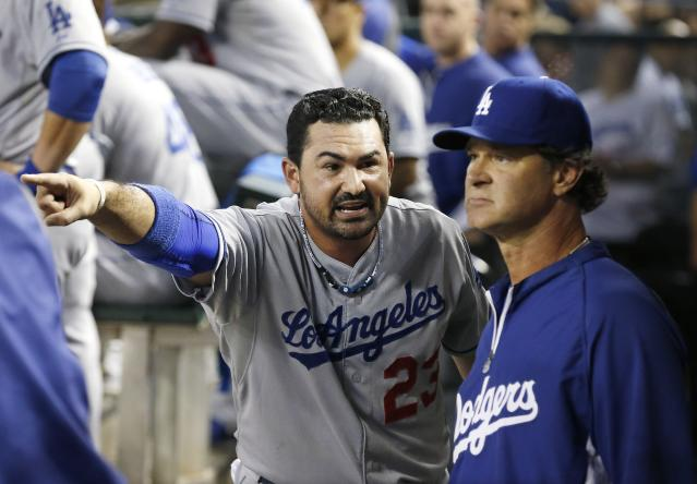 Los Angeles Dodgers' Adrian Gonzalez (23) tries to explain to manager Don Mattingly why he argued a call that got him ejected in the sixth inning during a baseball game against the Arizona Diamondbacks on Wednesday, Sept. 18, 2013, in Phoenix. (AP Photo/Ross D. Franklin)