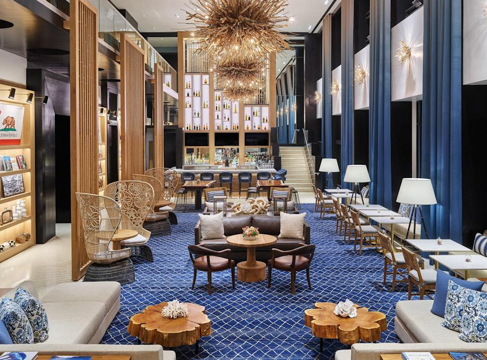 """<p><strong>Why did this hotel catch your attention?</strong><br> Despite its position downtown, Hotel Republic's lobby takes design cues from San Diego's coastal location, with blue carpets, chandeliers made of driftwood, and nautical tchotchkes. The vibe is relaxed but polished, with a bit of surviving panache from the building's former life as a W Hotel.</p> <p><strong>Tell us all about the accommodations. Any tips on what to book?</strong><br> Accommodations are nothing mind-blowing, but they're definitely comfortable, with modern, nautical vibes and a pleasing blue-and-white color palette. Most standard rooms clock in at 362 square feet, but you can bump up to a corner room or the Presidential Suite for more space.</p> <p><strong>Is there a charge for Wi-Fi?</strong><br> Wi-Fi is $9.95/day for high-speed internet access and $14.95/day for an enhanced option.</p> <p><strong>Drinking and dining—what are we looking at?</strong><br> The rooftop is a charming place for a drink at sunset, but you'd be better off heading to nearby Little Italy, home to some of San Diego's best <a href=""""https://www.cntraveler.com/gallery/best-restaurants-in-san-diego?mbid=synd_yahoo_rss"""" rel=""""nofollow noopener"""" target=""""_blank"""" data-ylk=""""slk:restaurants"""" class=""""link rapid-noclick-resp"""">restaurants</a> and <a href=""""https://www.cntraveler.com/gallery/best-bars-in-san-diego?mbid=synd_yahoo_rss"""" rel=""""nofollow noopener"""" target=""""_blank"""" data-ylk=""""slk:bars"""" class=""""link rapid-noclick-resp"""">bars</a>.</p> <p><strong>And the service?</strong> From the front desk staffers to the valet team, everyone's warm and friendly. They also welcome dogs.</p> <p><strong>What type of travelers will you find here?</strong><br> The hotel—which is sophisticated without being stuffy, hip without being exclusive, and downtown without being in the thick of the party scene—draws a varied crowd. You'll see couples, families, friend groups, you name it.</p> <p><strong>What about the neighborhood? What else will we find h"""
