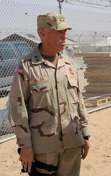Then-US Major General Geoffrey Miller, deputy commander for detainee operations in Iraq, at the US-run Camp Bucca detention camp on the outskirts of Umm Qasr, on July 16, 2004 (AFP Photo/Sam Dagher)