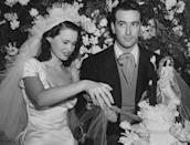 """<p>Gloria Vanderbilt (a.k.a. Anderson Cooper's mother) married her first husband Pat DiCicco in 1941, when she was just 17 (and yep, she wore an iconic set of Vanderbilt pearls, because as the saying goes, """"All Vanderbilt Women Have Pearls""""). They divorced just four years later. (She next married Leopold Stokowski, then Sidney Lumet—more on that in the next slide—and finally, Wyatt Cooper, Anderson's father.)</p><p>Couple of fun facts: The train on Gloria's dress was 30-feet long, and that little cake topper is wearing a replica of her outfit. </p>"""