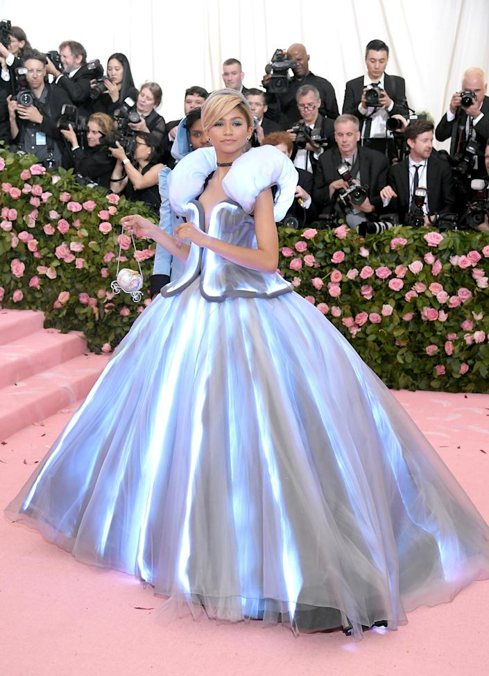"""<p>So little time! The actress revealed last week that she <a href=""""https://people.com/style/zendaya-not-attending-met-gala-2021-work-on-euphoria/"""" rel=""""nofollow noopener"""" target=""""_blank"""" data-ylk=""""slk:couldn't make"""" class=""""link rapid-noclick-resp"""">couldn't make</a> the benefit due to a scheduling conflict.</p> <p>""""I will be on <em>Euphoria</em>. My fans are going to be very upset with me,"""" Zendaya told <a href=""""https://www.youtube.com/watch?v=A_CeaU8f5ms&t=123s"""" rel=""""nofollow noopener"""" target=""""_blank"""" data-ylk=""""slk:Extra TV."""" class=""""link rapid-noclick-resp""""><em>Extra TV.</em></a></p> <p>Her <em>Dune</em> costar — and <a href=""""https://people.com/style/met-gala-2021-theme-explainer-event-details/"""" rel=""""nofollow noopener"""" target=""""_blank"""" data-ylk=""""slk:Met Gala co-chair"""" class=""""link rapid-noclick-resp"""">Met Gala co-chair</a>! — Timothée Chalamet interjected, """"Bummer, bummer,"""" during the joint interview.</p>"""