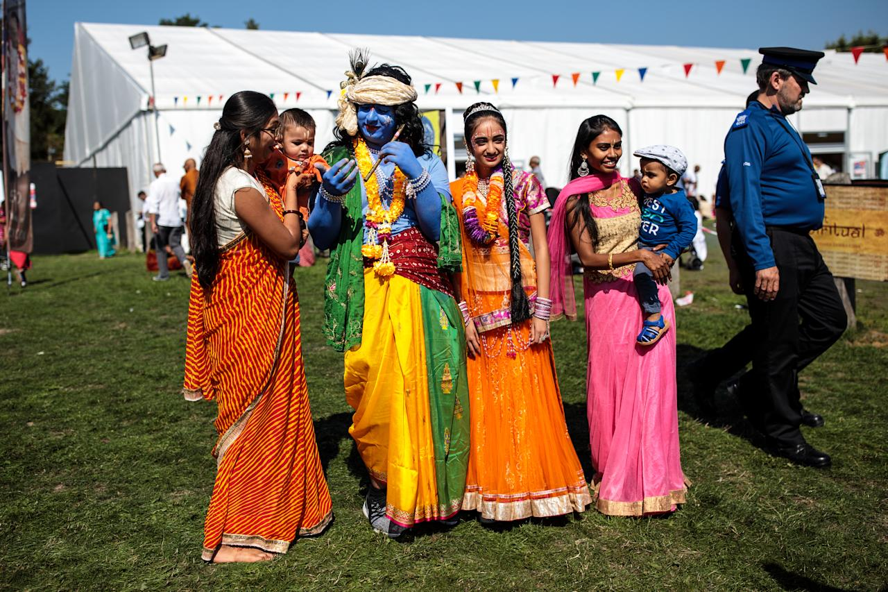 <p>People dressed as the Hindu god Lord Krishna and his consort pose for photographs with guests during the Janmashtami Festival at Bhaktivedanta Manor on September 2, 2018 in Watford, England. Around 70,000 people are expected to attend the Krishna Janmashtami Festival celebrations over two days at Bhaktivedanta Manor to mark the birth of the Hindu god Lord Krishna. The event is thought to be one of the largest Hindu festival gatherings outside of India. (Photo by Jack Taylor/Getty Images) </p>