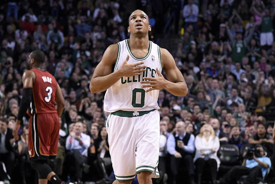 BOSTON, MA - MARCH 19: Avery Bradley #0 of the Boston Celtics celebrates after a play against the Miami Heat on March 19, 2014 at the TD Garden in Boston, Massachusetts. (Photo by Brian Babineau/NBAE via Getty Images)