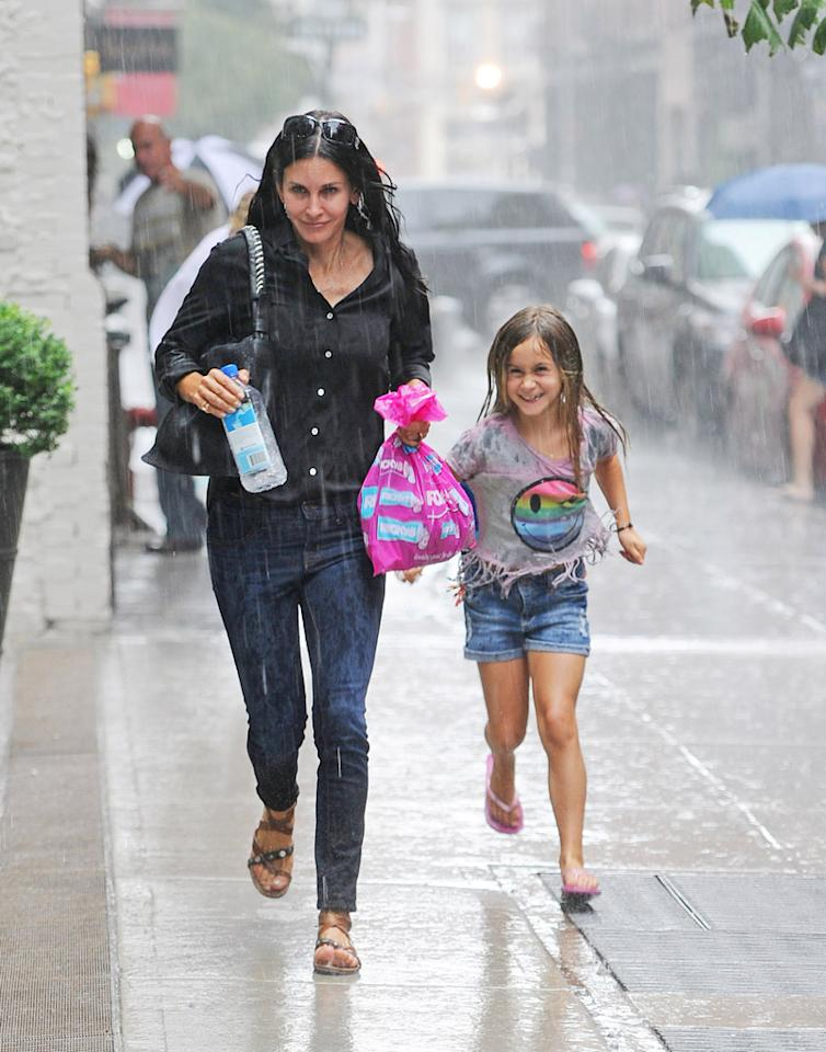 During a Sunday afternoon out in New York City, Courteney Cox and her daughter, Coco, found themselves caught in a sudden rainstorm … without an umbrella. Rather than take shelter in a doorway or under an awning, the duo made a run for it … and 8-year-old Coco clearly looked like she was having a grand old time in the downpour. (7/29/2012)