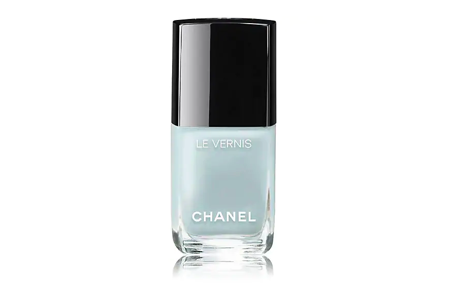 """<h3>Chanel Le Vernis Bleu Pastel</h3><br>Frosty blue feels inherently youthful, while the designer label ensures this shade knows no age. """"Chanel's Bleu Pastel shade is the prettiest <a href=""""https://www.refinery29.com/en-us/blue-nail-polish"""" rel=""""nofollow noopener"""" target=""""_blank"""" data-ylk=""""slk:muted baby blue"""" class=""""link rapid-noclick-resp"""">muted baby blue</a>,"""" says Abramcyk. """"It's a universal pastel for spring, and looks gorgeous on everyone.""""<br><br><strong>Chanel</strong> Le Vernis Longwear Nail Color in Bleu Pastel, $, available at <a href=""""https://go.skimresources.com/?id=30283X879131&url=https%3A%2F%2Fwww.barneys.com%2Fproduct%2Fchanel-le-vernis-longwear-nail-color-505289820.html%3Futm_source%3Dgoogle%26utm_medium%3Dcpc%26utm_content%3DProduct-Type-womens-cosmetics-nails%26utm_keyword%3DPRODUCT_GROUP%26utm_campaign%3DBNY-PLA-US-GGL-NB-Product-Type_PSP%26gclid%3DEAIaIQobChMIh5z9_e7h4AIVzB-GCh0g3wbaEAYYASABEgJEWfD_BwE%26gclsrc%3Daw.ds"""" rel=""""nofollow noopener"""" target=""""_blank"""" data-ylk=""""slk:Barneys New York"""" class=""""link rapid-noclick-resp"""">Barneys New York</a>"""