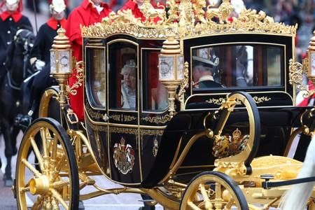 Britain's Queen Elizabeth is driven by carriage as she returns to Buckingham Palace after delivering the State Opening of Parliament in London