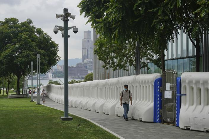 A man wearing face mask to prevent the spread of coronavirus walks outside government headquarters in Hong Kong, Thursday, May 13, 2021. (I AP Photo/Vincent Yu)