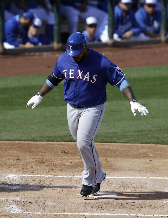 Texas Rangers' Prince Fielder throws his arms out after crossing home plate on a solo home run that came off a pitch from Kansas City Royals' Danny Duffy in the third inning of an exhibition baseball game on Thursday Feb. 27, 2014, in Surprise, Ariz. (AP Photo/Tony Gutierrez)