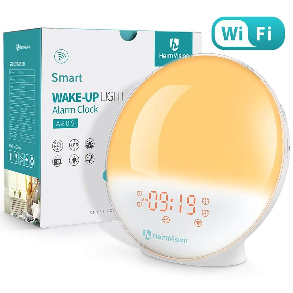 """<strong><h3><a href=""""https://amzn.to/2Qf5sQv"""" rel=""""nofollow noopener"""" target=""""_blank"""" data-ylk=""""slk:Light-Therapy Alarm Clock"""" class=""""link rapid-noclick-resp"""">Light-Therapy Alarm Clock</a></h3></strong><br>These clocks work by using a gradually-brightening light (instead of or in conjunction with sound) to <a href=""""https://www.refinery29.com/en-us/sad-lamps-lights"""" rel=""""nofollow noopener"""" target=""""_blank"""" data-ylk=""""slk:simulate sunlight"""" class=""""link rapid-noclick-resp"""">simulate sunlight</a> for a natural sleep to waking process — this model combines five natural sound options with 20 different brightness settings that reviewers describe as an entirely gentle wake-up experience. <br><br>(Not to mention, it also has an Amazon's Choice seal of approval, over 3,000 reviews, and a 4.4-out-of-5-star rating to its name.)<br><br><strong>HeimVision</strong> Sunrise Alarm Clock, Smart Wake Up Light Sleep Aid, $, available at <a href=""""https://amzn.to/2Qf5sQv"""" rel=""""nofollow noopener"""" target=""""_blank"""" data-ylk=""""slk:Amazon"""" class=""""link rapid-noclick-resp"""">Amazon</a>"""