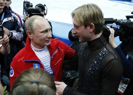 Russian President Putin greets Plushenko, a member of the gold medal-winning Russian figure skating team, during the 2014 Sochi Winter Olympics