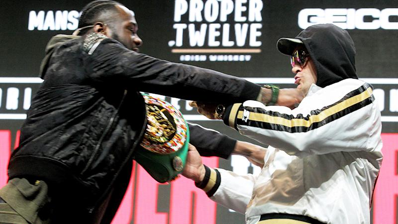 Deontay Wilder and Tyson Fury, pictured here shoving each other at their press conference.
