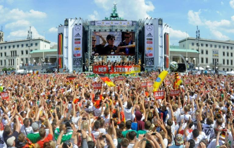 Germany head coach Joachim Loew is displayed on a giant screen as thousands of football fans in Berlin celebrate Germany's win at the 2014 World Cup