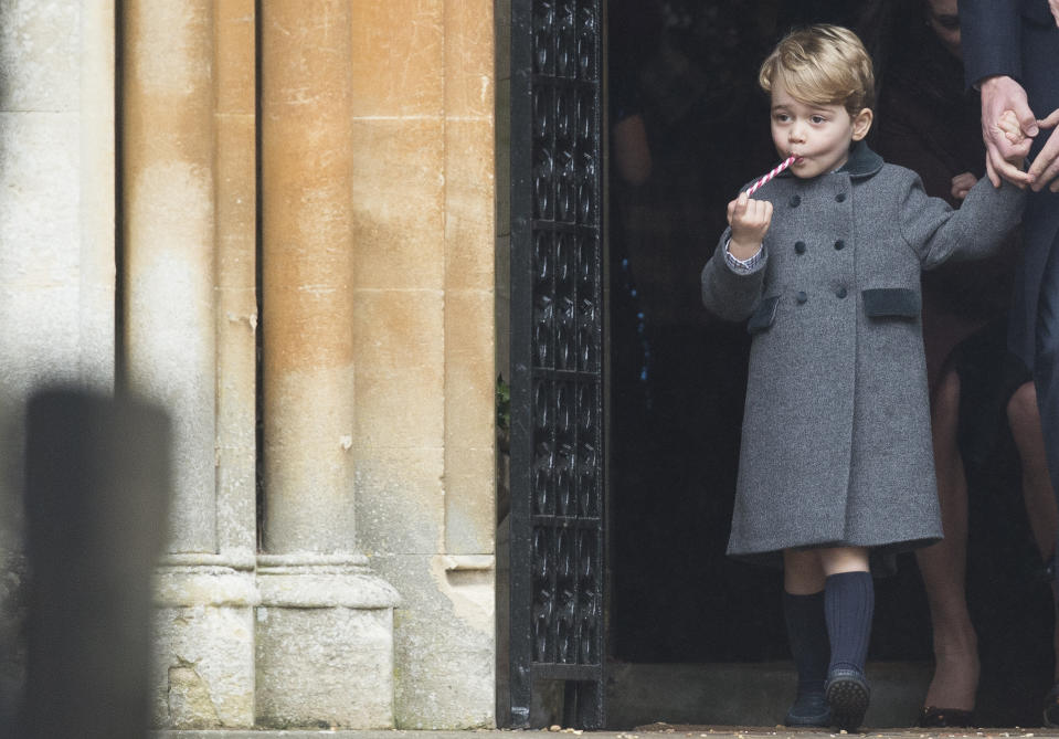 <p>Prince George at Church on Christmas Day in 2016 in Bucklebury, a rare Christmas without the Queen. He was given a candy cane at church. (Samir Hussein/Samir Hussein/WireImage)</p>