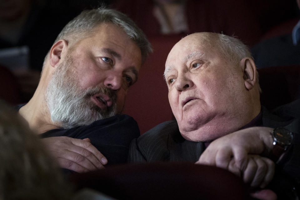FILE - In this Nov. 8, 2018 file photo, former Soviet leader Mikhail Gorbachev, right, and Dmitry Muratov, former editor of Novaya Gazeta attend the Moscow premier of a film made by Werner Herzog and British filmmaker Andre Singer based on their conversations, in Moscow, Russia. The Norwegian Nobel Committee on Friday, Oct. 8, 2021 awareded the Nobel Peace Prize to journalists Maria Ressa of the Philippines and Dmitry Muratov of Russia for their fight for freedom of expression. (AP Photo/Alexander Zemlianichenko, File)