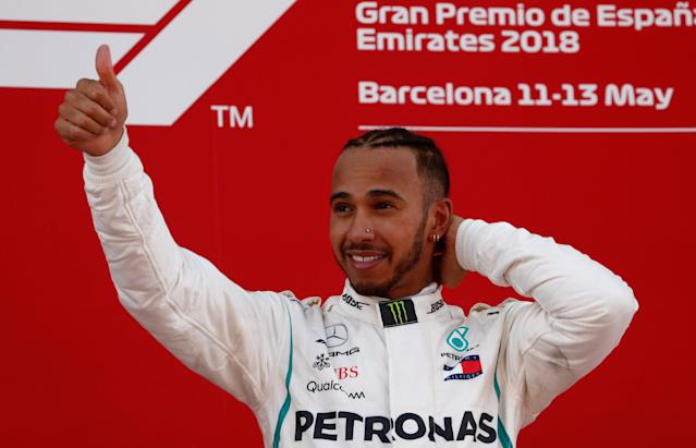 Formula One F1 - Spanish Grand Prix - Circuit de Barcelona-Catalunya, Barcelona, Spain - May 13, 2018 Mercedes' Lewis Hamilton celebrates on the podium after winning the race REUTERS/Juan Medina