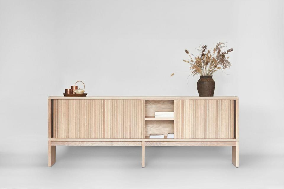"""<p>Canadian designer Thom Fougere founded his eponymous Winnipeg studio in 2015 with the aim of investigating how we live and interact with objects in the home. His latest collection, created exclusively for Toronto lifestyle store Mjolk, is an ode to slow, subtle design and craftsmanship. It includes the 'Tambour' cabinet, a handcrafted solid oak unit with sliding doors that wrap around the back providing a 'tactile and auditory' experience. Approx £3,704, <a href=""""https://www.mjolk.ca/"""" rel=""""nofollow noopener"""" target=""""_blank"""" data-ylk=""""slk:mjolk.ca"""" class=""""link rapid-noclick-resp"""">mjolk.ca </a></p>"""