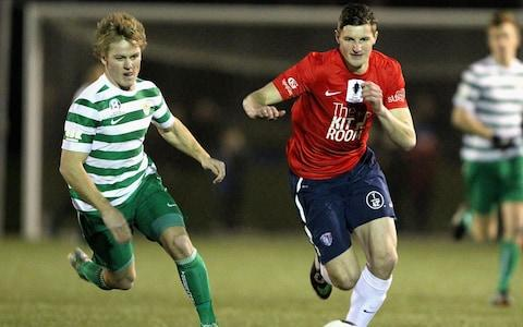Andy Brennan (R) of South Hobart controls the ball during the FFA Cup match between South Hobart and Tuggeranong at KGV Park on August 5, 2014 in Hobart, Australia - Credit: Getty Images