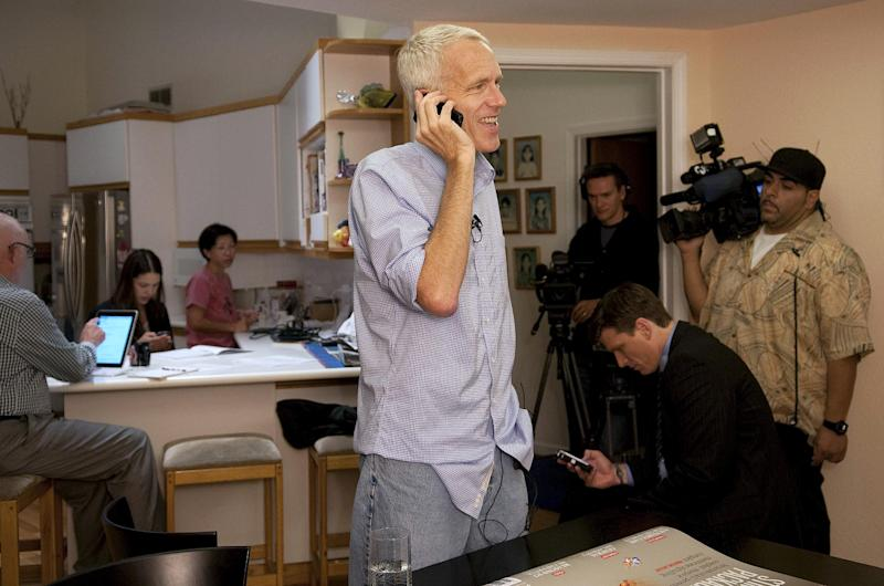 In this image release by the Stanford News Service, Brian Kobilka talks on the telephone to reporters after receiving news of his Nobel Prize in Chemistry at his home in Palo Alto, Calif., Wednesday, Oct. 10, 2012. Kobilka and Duke University professor Robert Lefkowitz won the Nobel Prize in chemistry Wednesday for studies of protein receptors that let body cells sense and respond to outside signals like danger or the flavor of food. Such studies are key for developing better drugs. (AP Photo/Stanford News Service, Linda A. Cicero) MANDATORY CREDIT