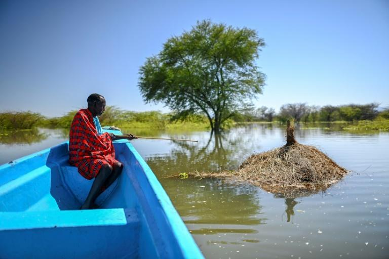 Richard Lichan Lekuterer, 60, sits in a boat as it glides above what used to be his homestead