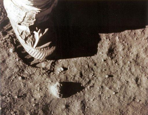 Apollo 11 commander Neil Armstrong's right foot leaves a footprint in the lunar soil July 20, 1969