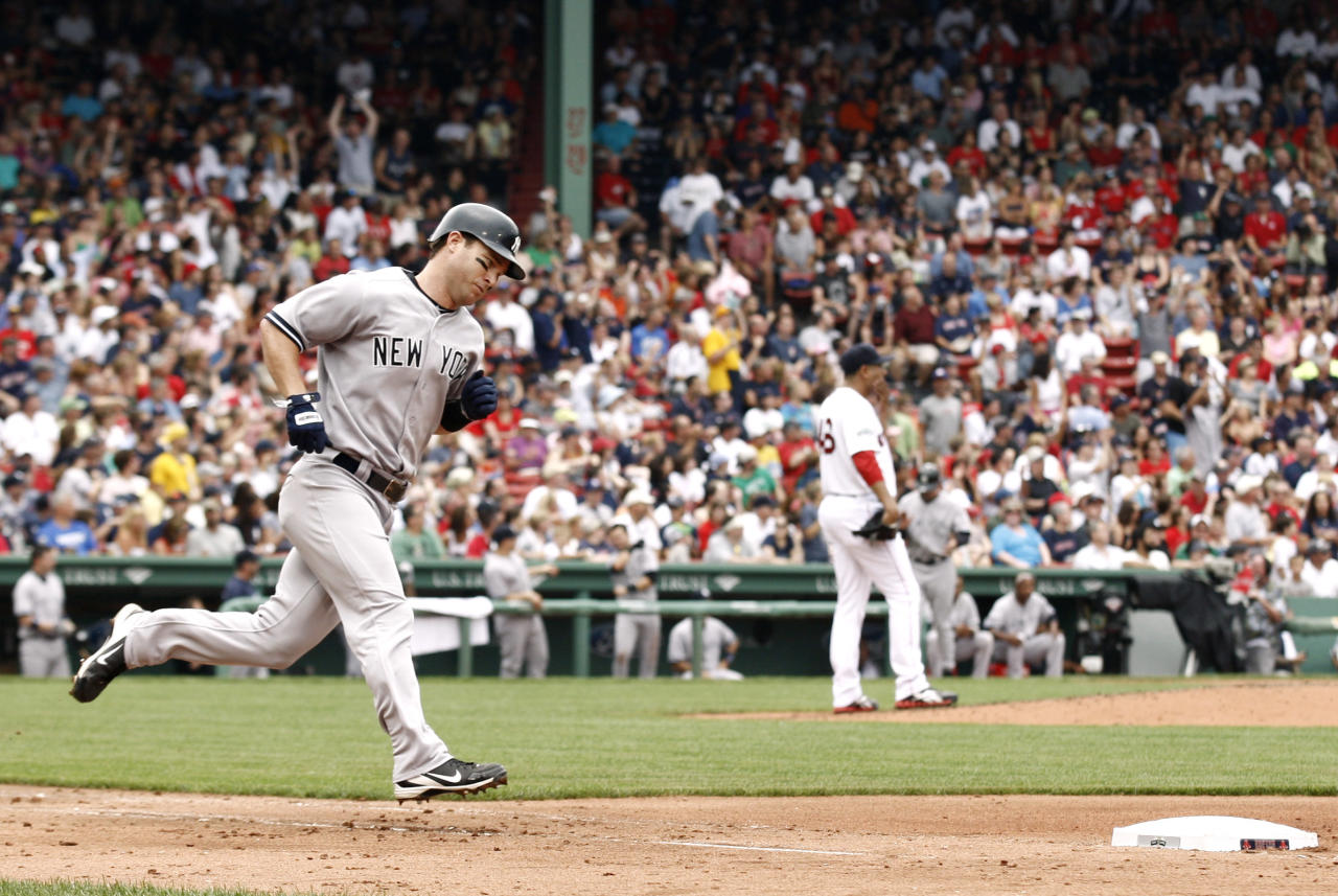 BOSTON, MA - JULY 7: Jayson Nix #17 of the New York Yankees rounds the bases after his home run off of Franklin Morales #46 of the Boston Red Sox (R) during the fourth inning of game one of a doubleheader at Fenway Park on July 7, 2012 in Boston, Massachusetts. (Photo by Winslow Townson/Getty Images)