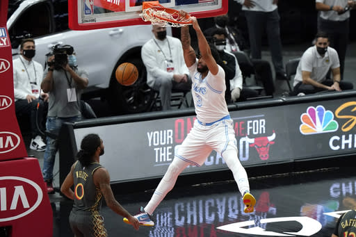Los Angeles Lakers forward Anthony Davis dunks as Chicago Bulls guard Coby White watches during the first half of an NBA basketball game in Chicago, Saturday, Jan. 23, 2021. (AP Photo/Nam Y. Huh)