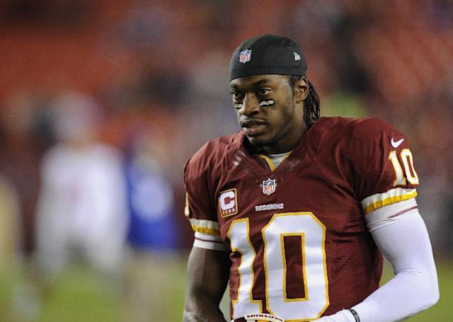 Washington Redskins quarterback Robert Griffin III (10) looks on during warm ups before an NFL football game against the New York Giants, Sunday, Dec. 1, 2013, in Landover, Md. (AP Photo/Nick Wass)