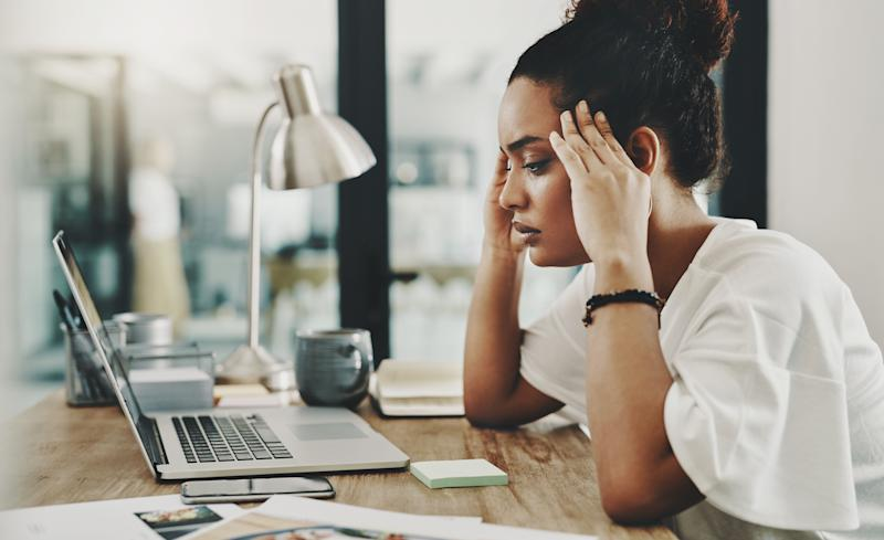 Over time, the fear of getting laid off can take a toll on your mental and physical health.  (Delmaine Donson via Getty Images)
