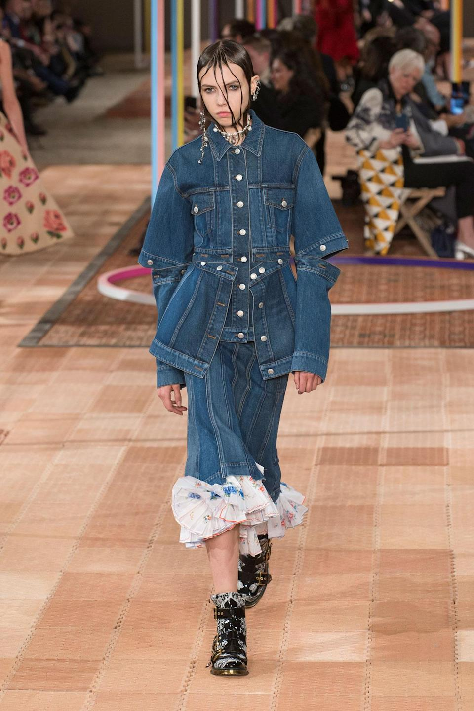 <p>Re-worked denim jacket and skirt with pleated bottom from the SS18 Alexander McQueen collection. (Photo: ImaxTree) </p>