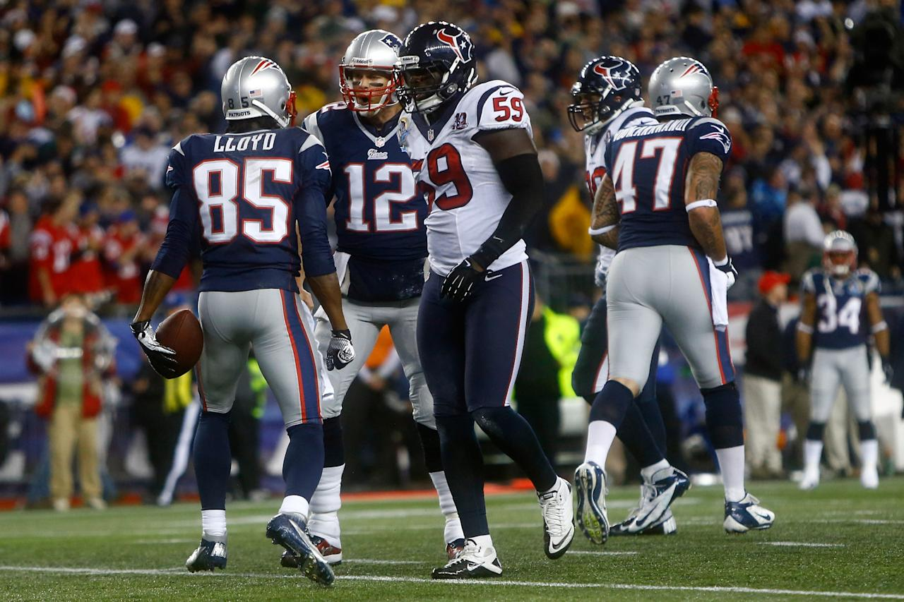 FOXBORO, MA - DECEMBER 10:  Wide receiver Brandon Lloyd #85 and quarterback Tom Brady #12 of the New England Patriots react after Lloyd catches a 37-yard touchdown pass in the first quarter against the Houston Texans at Gillette Stadium on December 10, 2012 in Foxboro, Massachusetts.  (Photo by Jared Wickerham/Getty Images)