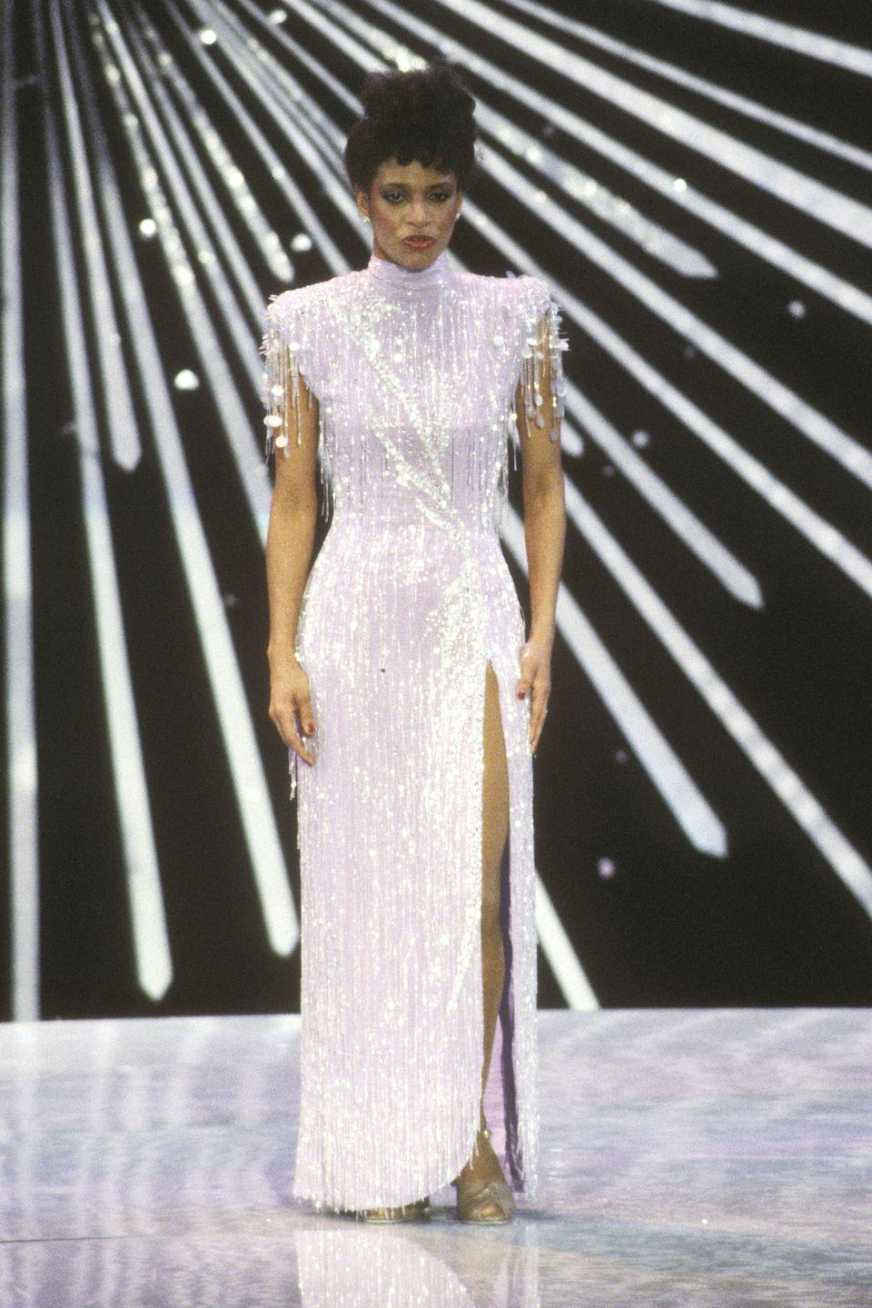 <p>Bold shoulders, thigh-high slit, all-over embellishments, Debbie Allen represented the best of '80s fashion at the 1982 awards ceremony. </p>
