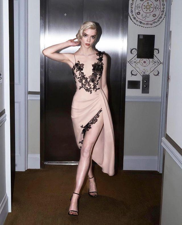 """<p>It's been a successful awards season for Anya Taylor-Joy who won again at the 2021 SAG Awards for her turn in The Queen's Gambit. To accept her accolade, the actress wore a nude Vera Wang dress with black lace accents and strappy Stuart Weitzman sandals. </p><p>Photograph by Nolan Zangas.</p><p><a href=""""https://www.instagram.com/p/CNRJH2ZBYG3/?utm_source=ig_embed&utm_campaign=loading"""" rel=""""nofollow noopener"""" target=""""_blank"""" data-ylk=""""slk:See the original post on Instagram"""" class=""""link rapid-noclick-resp"""">See the original post on Instagram</a></p>"""