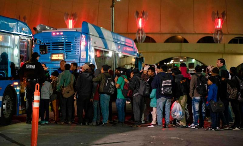 Asylum seekers board a bus after they were dropped off by Ice officials earlier at the Greyhound bus station in downtown El Paso, Texas, late on 23 December.