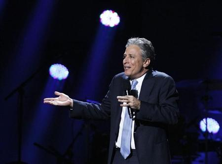 """Comedian Jon Stewart speaks during the """"12-12-12"""" benefit concert for victims of Superstorm Sandy at Madison Square Garden in New York"""