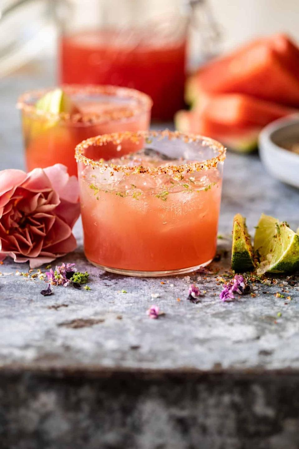 """<p>Californians know what's good, especially when it comes to cocktails. These fun-filled palomas include fresh watermelon juice, tequila mixed with lime juice, sweet Rosè wine, and a dash of sparkling water. Finish this cocktail off with a chili rim for best results.</p> <p><strong>Get the recipe</strong>: <a href=""""https://www.popsugar.com/buy?url=https%3A%2F%2Fwww.halfbakedharvest.com%2Fwatermelon-rose-paloma%2F&p_name=watermelon%20Ros%C3%A8%20paloma&retailer=halfbakedharvest.com&evar1=yum%3Aus&evar9=47471653&evar98=https%3A%2F%2Fwww.popsugar.com%2Ffood%2Fphoto-gallery%2F47471653%2Fimage%2F47473186%2FCalifornia-Paloma&list1=cocktails%2Cdrinks%2Calcohol%2Crecipes&prop13=api&pdata=1"""" class=""""link rapid-noclick-resp"""" rel=""""nofollow noopener"""" target=""""_blank"""" data-ylk=""""slk:watermelon Rosè paloma"""">watermelon Rosè paloma</a></p>"""